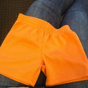 Orange basketball shorts